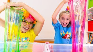 Alicia and Mom having fun making slime with funny balloons and glitter