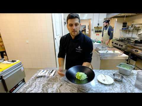 João Oliveira prepares a dessert with green apple, wasabi and fennel