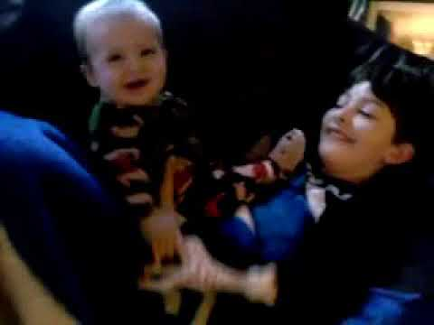 Cam attacks Riley with giraffe