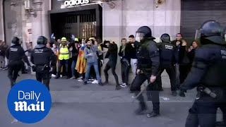 Riot police clash with pro-independence Catalan protesters
