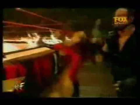 Undertaker burns kane's leg.