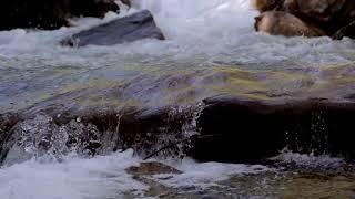 water flowing between the rock