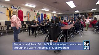 Students in need receive new g…