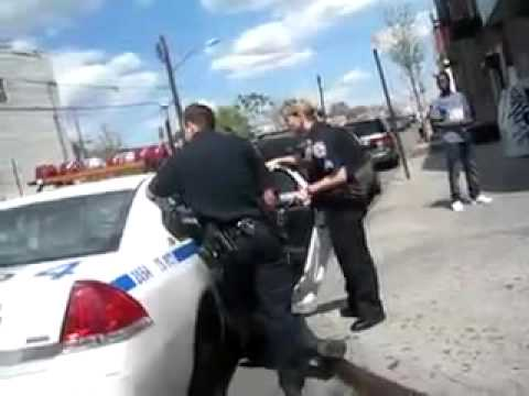 Police Officers Arresting Someone