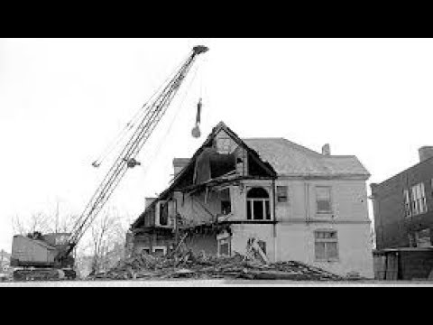 Demolition. Wrecking ball and other methods of destruction of houses