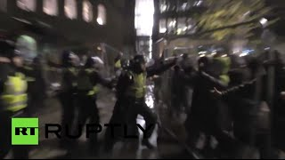 Pro-refugee group break through police line in St Pancras