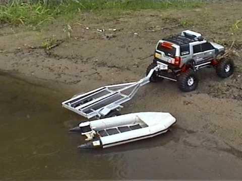 Rc LR3 crawler launching boat on trailer