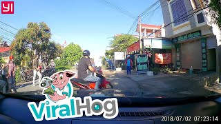 Close Call on Scooter Between Two Vehicles || ViralHog