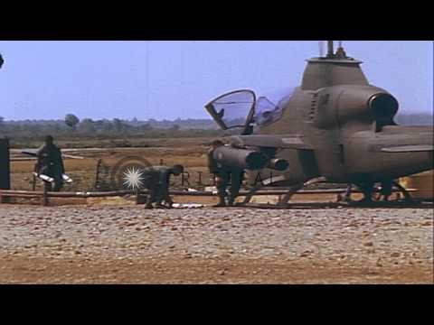 US Army helicopters AH-1G and OH-6A during operation in Vietnam. HD Stock Footage
