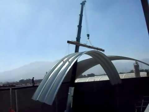 Montaje de arcotecho para naves industriales youtube for Calefactores para naves industriales