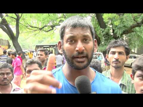 Chennai Floods - Actor vishal on a whirlwind tour to flood affected area to supply relief materials