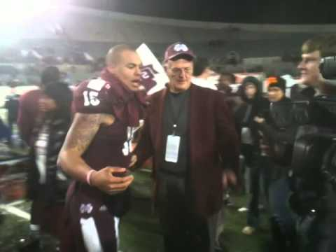Mississippi State quarterback Dak Prescott celebrates with MSU fans after 2013 Liberty Bowl