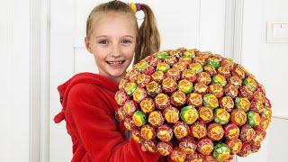Polina y pastel de piruletas