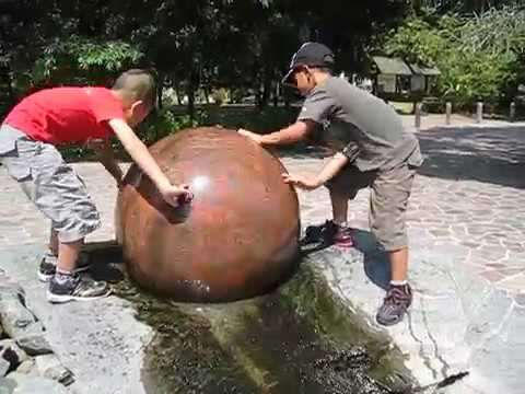 Kids playing with water ball fountain in Botanic Garden Singapore