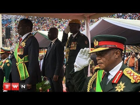 Crowds cheer as new president of Zimbabwe is sworn in