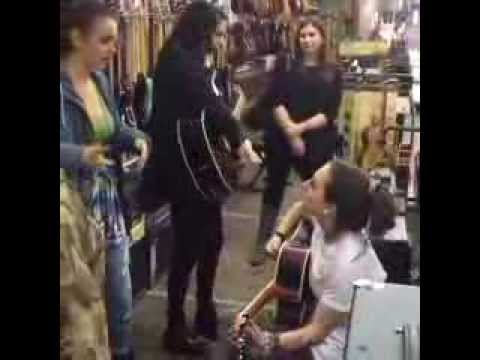 Cimorelli in a music instrument store in Valencia, Spain