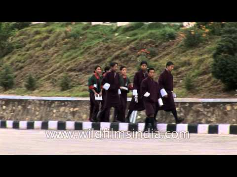 Students of Yangchenphug Higher Secondary School walking on the roadside in Bhutan