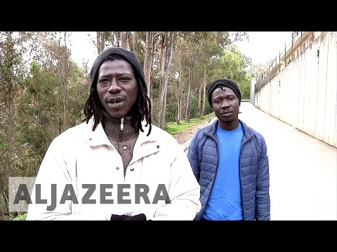 African refugees cross border fence for shelter in Ceuta