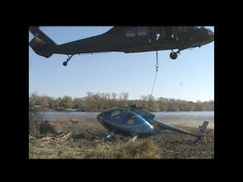 Blackhawk Helicopter lifts Police Helicopter