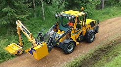 Wille 465 with Boom Flail Mower
