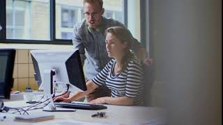 Young businesspeople using computer in office - Free Stock Footage HD