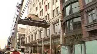 Bonnie and Clyde car lifted high above the streets of DC