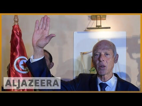 Exit polls project Saied to become Tunisia's new president