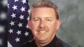 Police officer shot and killed by paroled gang member
