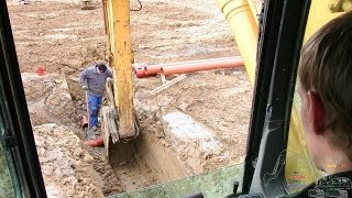 Digging A 2 String Sewer Trench In The Frozen Ground: Cab View