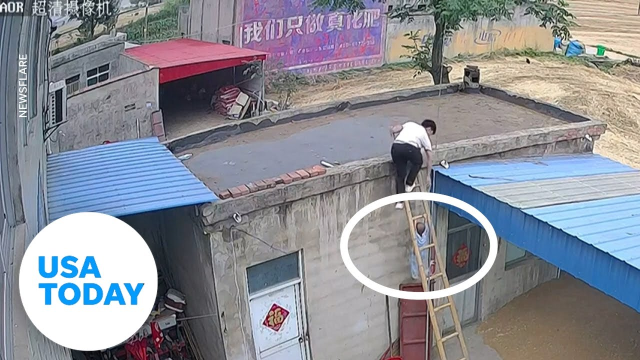 Toddler holds tightly to a ladder after attempting a terrifying climb   USA TODAY