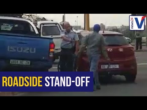 WATCH: Durban cops struggle to subdue knife-wielding man