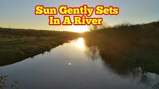 Sun Gently Sets In A River