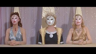 Ok, folks, how about some masked women from outer space? A group of...