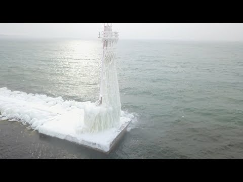 Drone captures frozen lighthouses on Lake Michigan