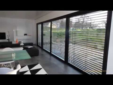 Nexthome Cration  Maison darchitecte contemporaine  toit plat et garage accol  YouTube