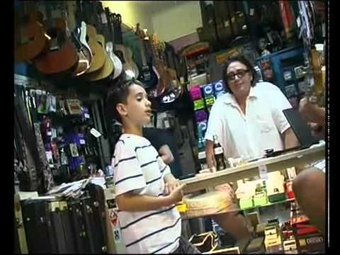 Little Boy Singing in Record Store