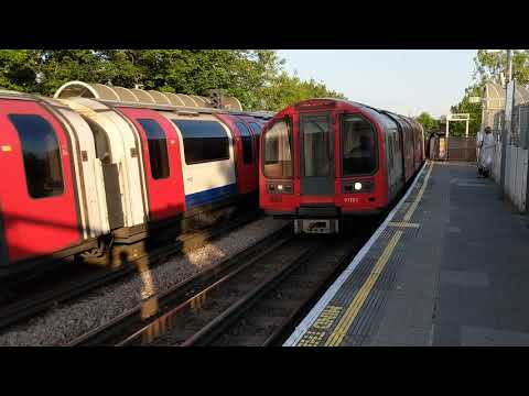 East Acton Station, Central Line. London Underground tube trains, east & west on a lovely day,
