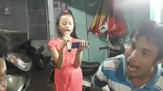 Bé Lê Vy hát bài Khăn Quàng Thắm Mãi Vai Em