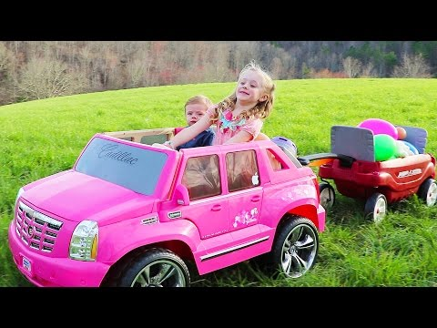 331a459bc64 Today Play Doh Girl is driving her pink Barbie Power Wheels ride on car toy  to hunt for giant surprise easter eggs filled with new toys.