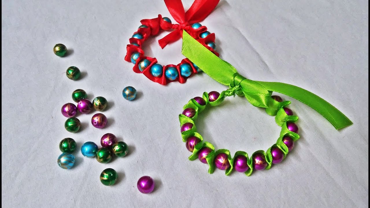 Ribbon and pearls bracelet tutorial how to make a for Pearl arts and crafts closing