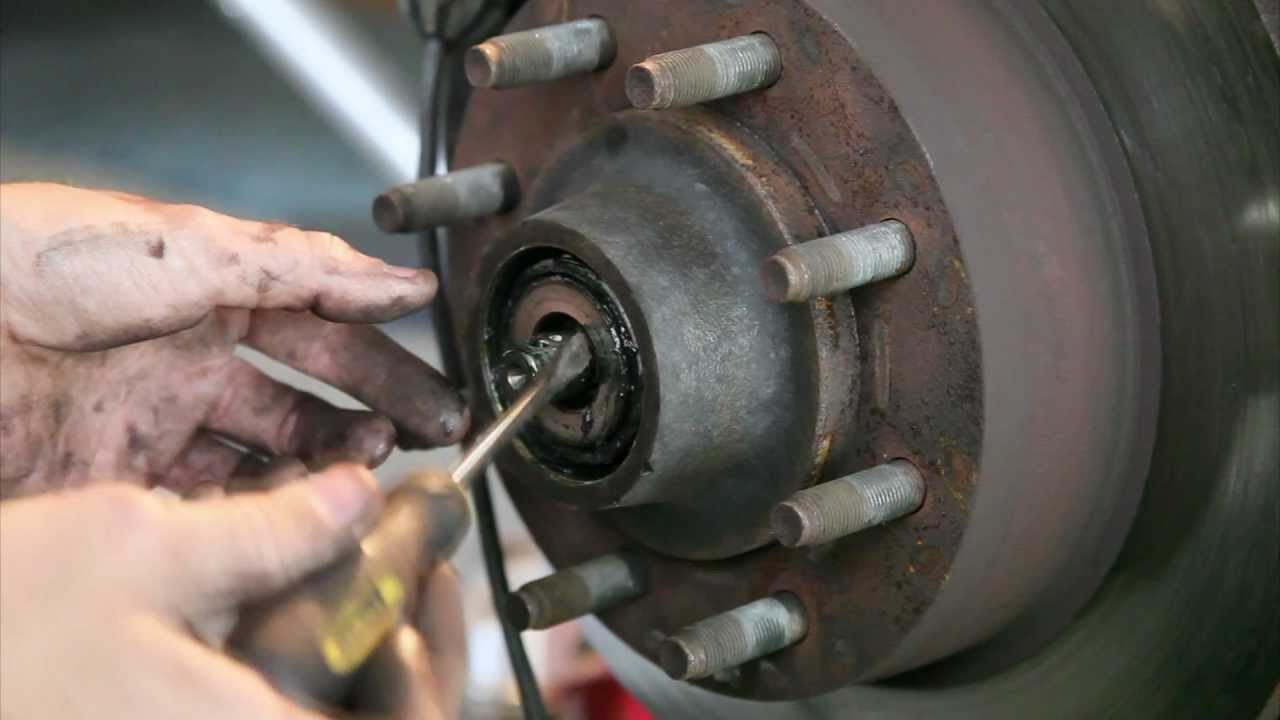 How to change the front brake pads and wheel bearings on a 2008 Ford E150  YouTube