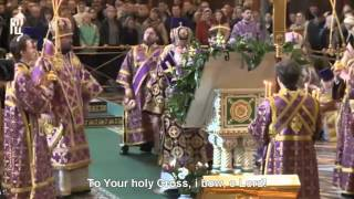 Russian Orthodox Patriarch Cyril bows to Holy Cross.