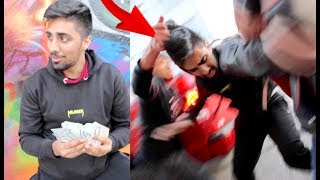MO VLOGS GETTING ROBBED IN THE HOOD PRANK!! *gone wrong*