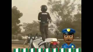 Nigerian Policeman Dancing on a Moving Bike