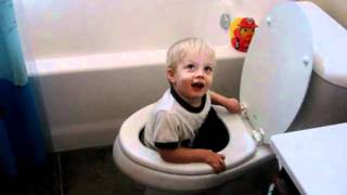 Toddler in toilet