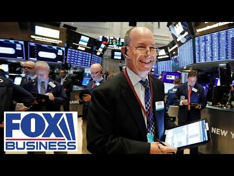 Stocks surge on surprise jobs gain