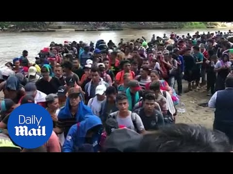 Second caravan continues journey as they cross into Mexico