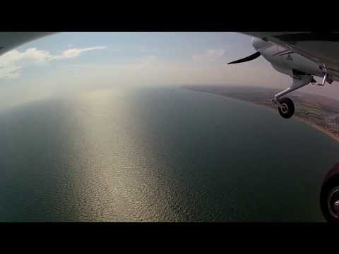 a flight from London to Seven Sisters Cliff and then to Shoreham