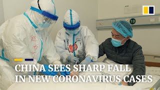 China sees sharp fall in new coronavirus cases as Beijing revises diagnosis protocol
