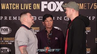 ALEXANDER DIMITRENKO TOWERS OVER ANDY RUIZ DURING THEIR FINAL PRESS CONFERENCE IN LA